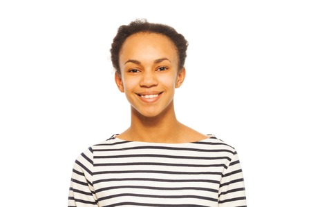 striped vest: Portrait of pretty smiling African girl,  teenager, isolated on white background Stock Photo