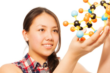 13: Beautiful young Asian student assembling molecule models, isolated on white background