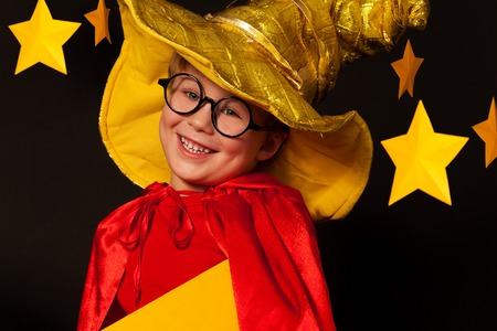 the watcher: Close up picture of five years old boy in glasses and sky watcher costume against starry night sky