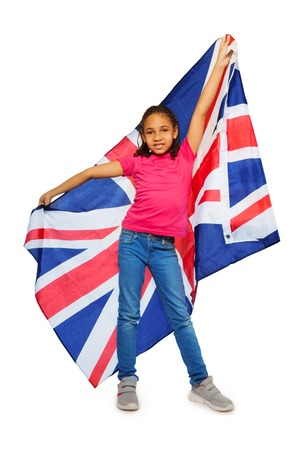 united: Happy black English learner proudly hold big UK banner isolated on white