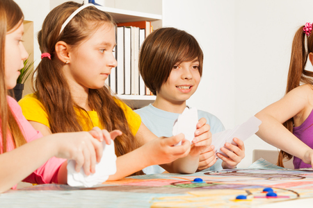 blanked: Four kids, friends, playing blanked cards for a pastime Stock Photo