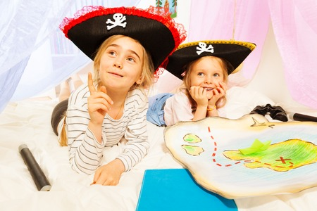 pirate girl: Two little girls in three-corned hats, playing pirates at imagine ship Stock Photo
