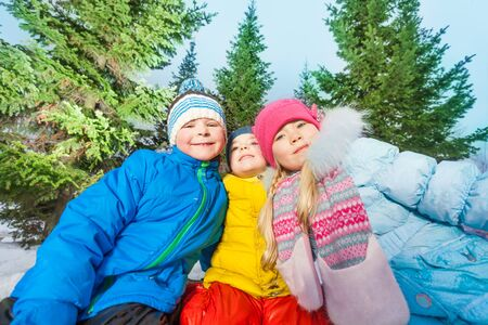 3 5 years: Funny portrait of boys and girls in the winter forest outside on sunny day