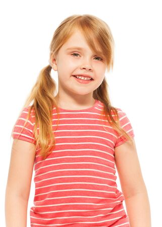 seven years: Close-up picture of beautiful blond seven years old girl with pig-tails, posing at the camera, isolated on white Stock Photo