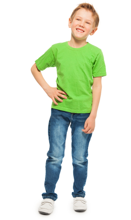 Full-length portrait of happy fair-haired boy in green t-shirt and denim, isolated on white