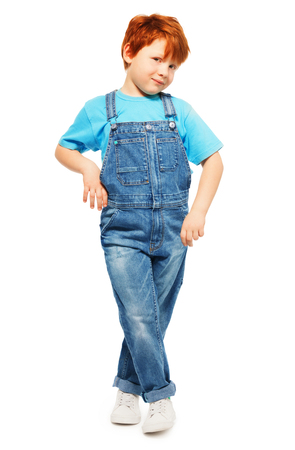 blue overall: Full-length photo of cute redheaded five years old boy in overall and blue t-shirt, isolated on white Stock Photo