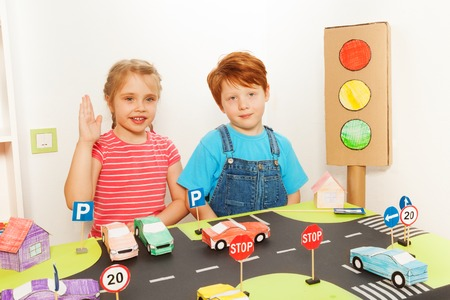 preschoolers: Two happy preschoolers, five years old boy and girl studying road traffic regulations in the kindergarten Stock Photo