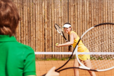 opponent: Tennis players, teenage girl and her opponent, playing a match on the clay court in summer Stock Photo