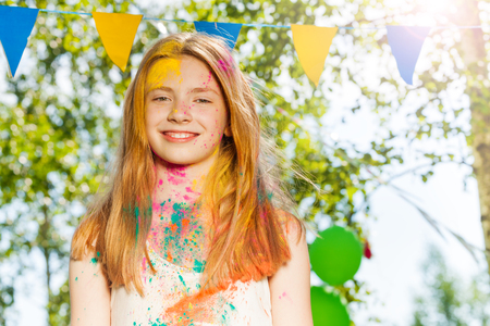 face covered: Portrait of happy young girl with face covered with colored powder on Holi color festival