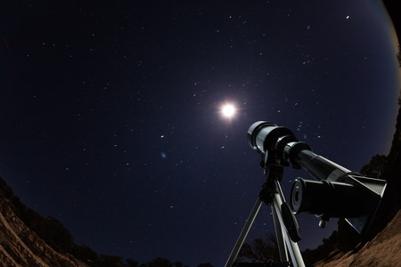 gazing: Telescope over night sky with stars and moon