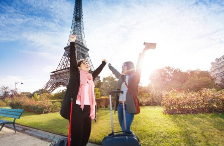 people travelling: Happy tourist meeting near the Eiffel Tower Stock Photo