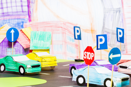 Road traffic in the toy town with handmade cars