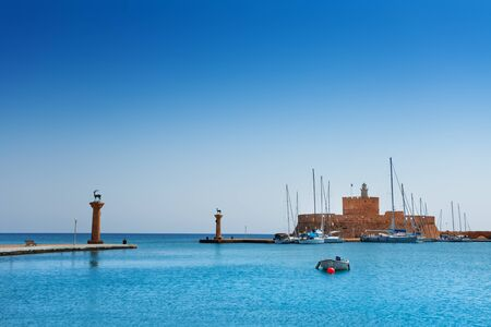 archaeological sites: Mandraki Harbor with the fortress of St. Nicholas Stock Photo