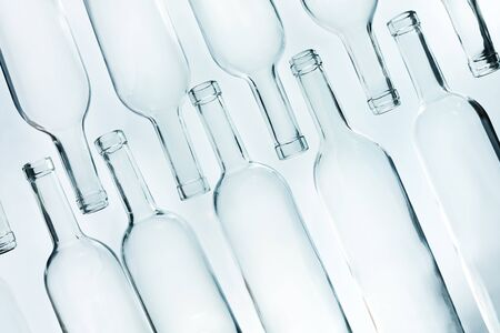 vitreous: Crystal glass empty bottles laying in two lines