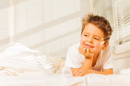 bedhead: Adorable little boy dreaming in his bedroom Stock Photo