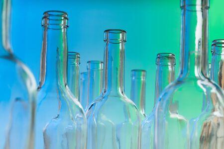 bottlenecks: Glass wine bottlenecks on blue background