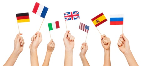Hands waving flags of USA and EU member-states