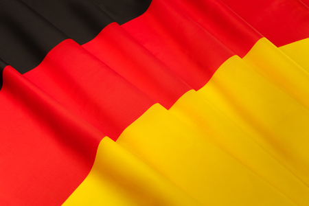 pleated: Picture of silky pleated German flag Stock Photo