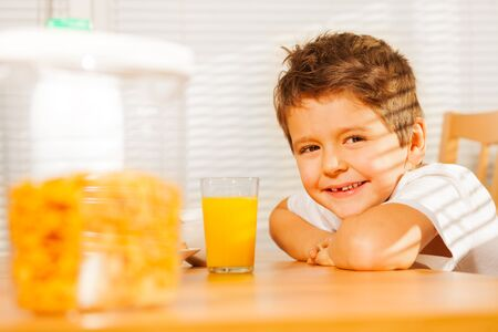 Happy smiling boy having healthy breakfast