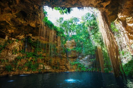 Sunbeams penetrating at Ik-Kil cenote inlet 写真素材