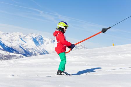 kids at the ski lift: Portrait of boy on button ski lift at sunny day