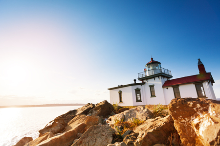 Scenic rock formations with West Point Lighthouse
