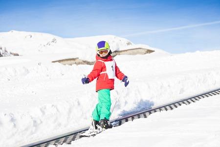 kids at the ski lift: Happy kid boy going uphill using a draglift