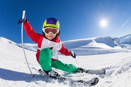 Little skier having fun at sunny snowy day 版權商用圖片