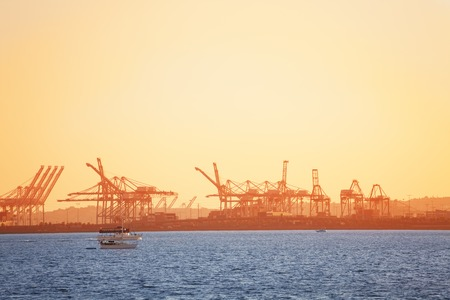 Long Beach shipping port with cranes at sunset Stock fotó - 76754537