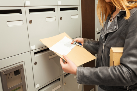 addressee: Womans hands holding blanked envelopes and box
