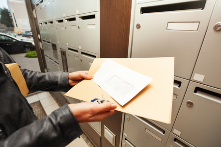 addressee: Womans hands holding envelopes with copy-space