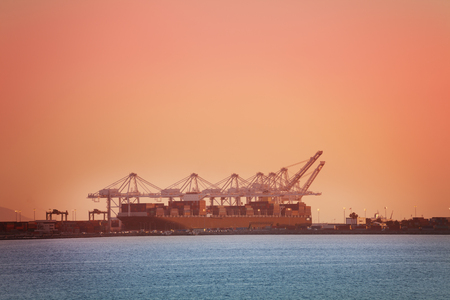 Crane loading containers on barge, Long Beach, USA