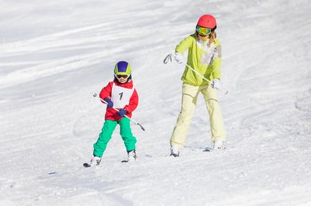 Little boy training skiing with female instructor Stock Photo