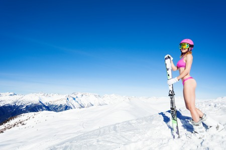 Sexy girl skier with mountain panorama behind Reklamní fotografie