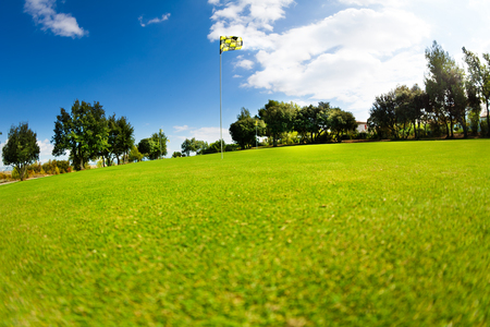 Beautiful landscape of golf course with flagstick Stock Photo