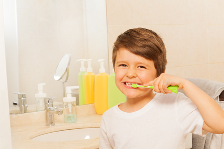 Kid boy happy to brush teeth in the morning