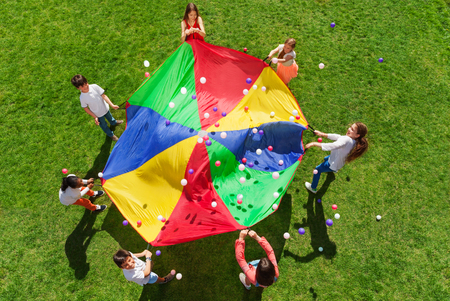 Kids standing in a circle and playing social game Stock Photo