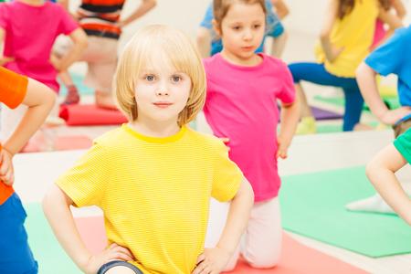 Kid boy practicing gymnastics in kindergarten Stock Photo