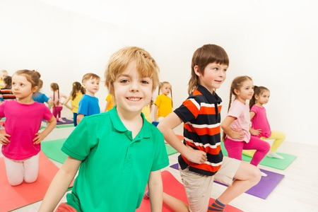 Portrait of smiling blond kid boy at sports lesson
