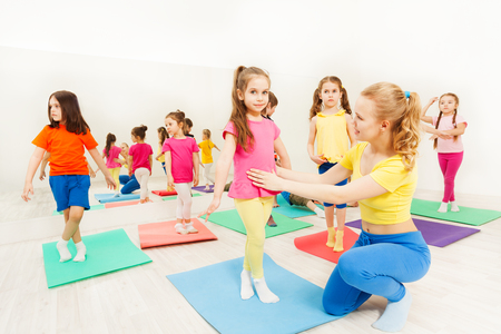 Dance teacher helping young dancer with her lesson Stock Photo