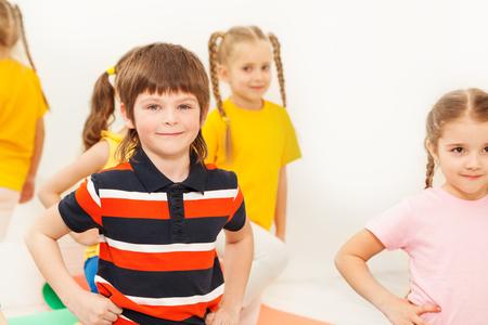 Happy boy practicing gymnastics in kindergarten