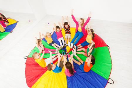 Kids and animator having fun playing circle games Stock Photo
