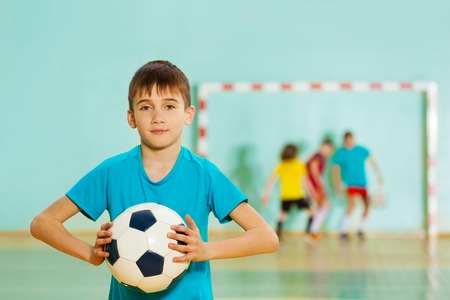 Young football player ready to throw soccer ball Stock Photo
