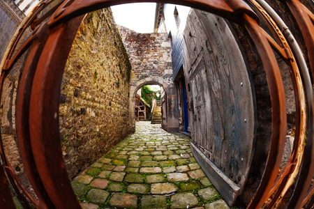 ancient pass: Medieval arched street of Honfleur old city Stock Photo