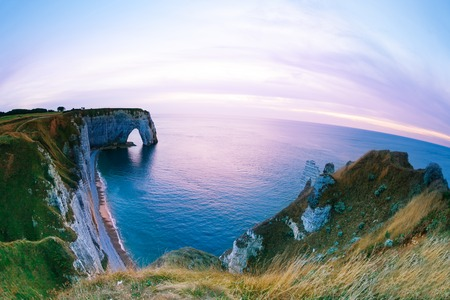 Scenic view of Etretat chalk cliffs at sunset