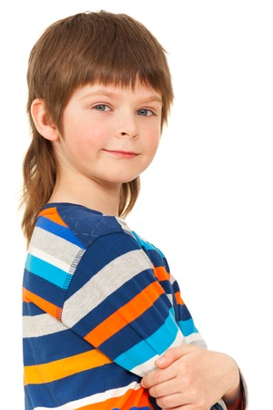 Caucasian boy standing with his arms folded