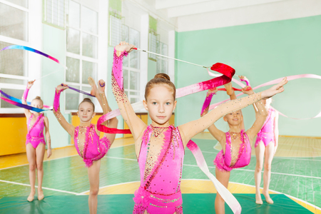 Girls doing rhythmic gymnastics with art ribbon