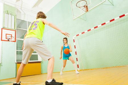 Girl dribbling the ball during basketball match