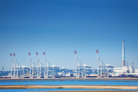 Port of Le Havre with portal cranes at sunny day