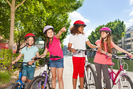 Little bike riders searching for right direction Stock Photo